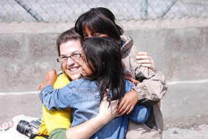 ER-Canada-Volunteer-Hugging-Kids