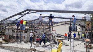 Volunteers build church